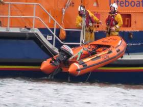 Portrush RNLI's all-weather lifeboat crew deploy the vessel's Y boat