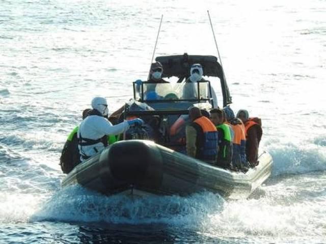 A rigid inflatable boat (RIB) of the LE James Joyce with migrants rescued on board