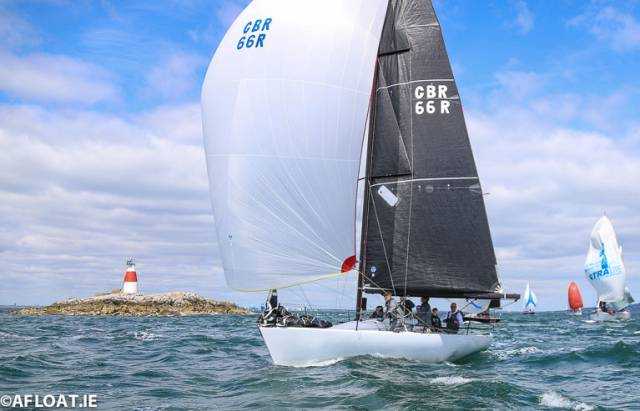 Nigel Biggs's Checkmate XVIII is now ten points clear at the top of the 21-boat fleet
