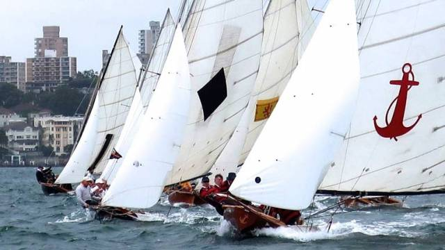 Over-canvassed, over-crewed, over-the-top…..the 1925 classic Yendys leads the vintage Sydney Harbour 18-footers