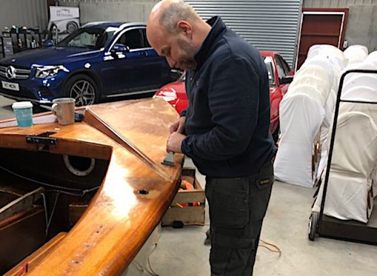 Nigel McNeely working on the restoration of the GP14 dinghy