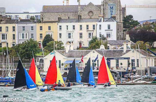 Firefly dinghy racing in front of the National Yacht Club. The Dun Laoghaire Harbour club will celebrates its 150th birthday next June with a special regatta