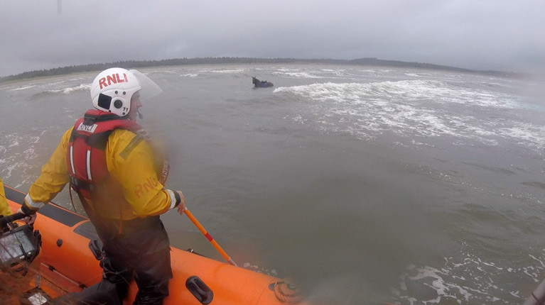 Lough Swilly RNLI approach the horse in the water at Murvagh