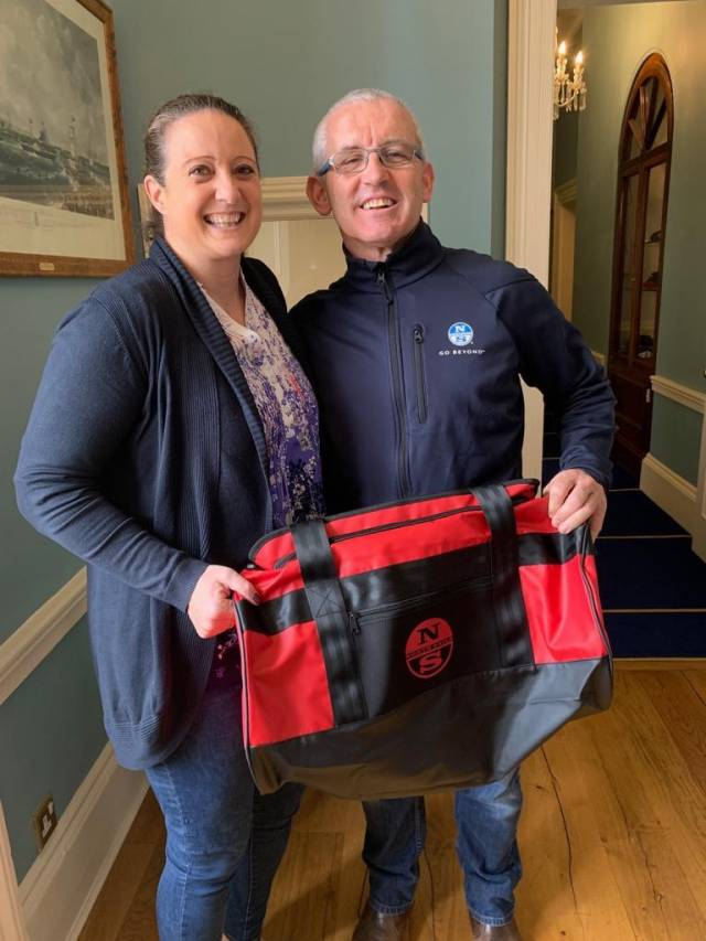 Gina Liuzzi is presented with her new North Sails Ireland holdall prize from Prof O'Connell at the Royal St. George