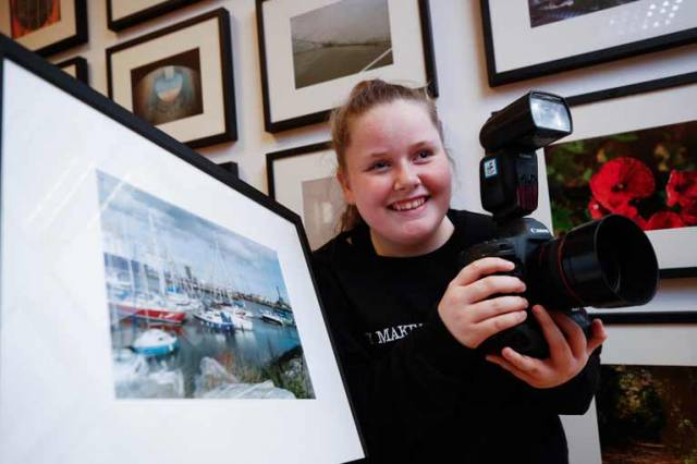 Niamh Carroll (age 12) from Ringsend College with her image of yachts and boats at Poolbeg Yacht and Boat Club marina from the exhibition