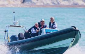 The public face of Fintan Cairns – at the helm (left) of the ICRA Support RIB with Barry Rose and Mike Broughton during the Anthony O'Leary-led 2014 re-taking of the Commodore's Cup