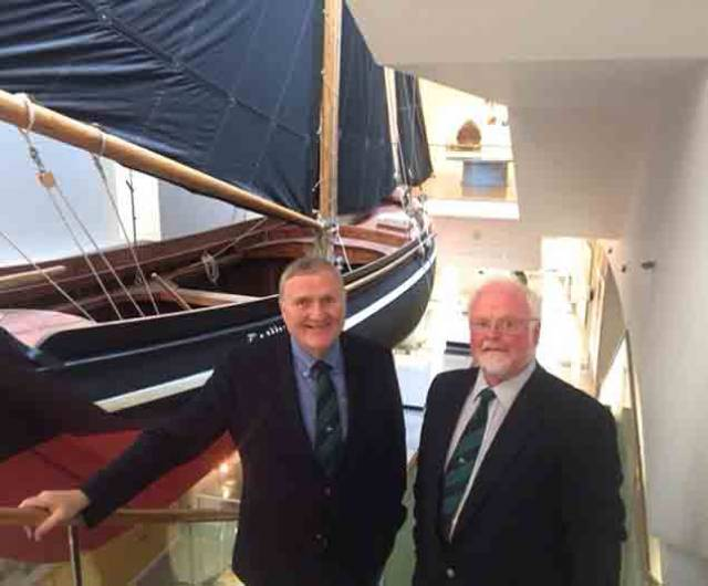 Jack Roy and Pierce Purcell enjoying the ambience of the maritime section in Galway Museum, where this full-size traditionally-rigged gleoteoig is suspended from the ceiling to make for a striking centrepiece in an exhibition which celebrates Galway's exceptionally long links with seafaring