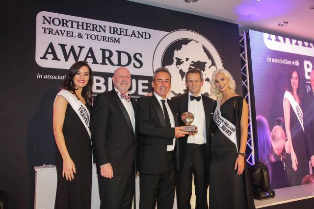 Paul Grant of Stena Line is pictured on stage at the Northern Ireland Travel and Tourism Awards, receiving the award for 'Best Ferry Company' from David Boyce of category sponsor Tourism Ireland. Also pictured is the host for the evening, TV Presenter Alexander Armstrong.
