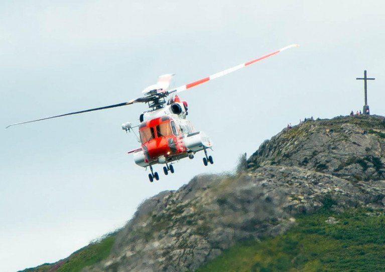 Rescue 116 flying with Bray Head in the background