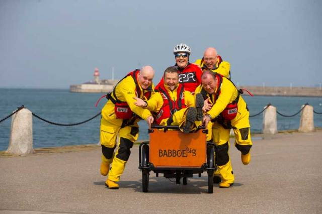 Volunteer crewmember and comedian PJ Gallagher joined members of Dun Laoghaire RNLI, where he volunteers, to help well-known fundraiser, Mary Nolan Hickey on her way as she cycles around Ireland for Mayday, Pictured with Mary and PJ are Kieran O'Connell (Colley), Coxswain Mark McGibney and Eamon O'Leary of Dun Laoghaire RNLI