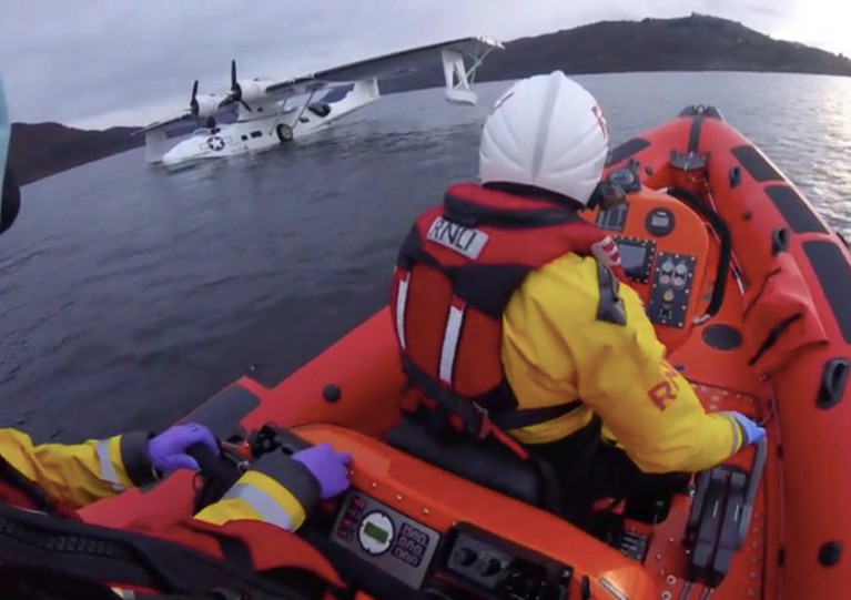Loch Ness RNLI's crew approach the flying boat with engine trouble