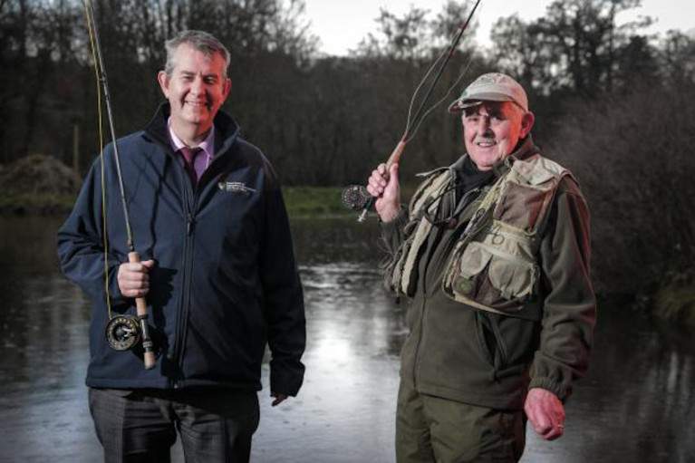 DAERA Minister Edwin Poots pictured with angler Joe Stitt at Shaws Bridge in Belfast to launch the 2020 angling season