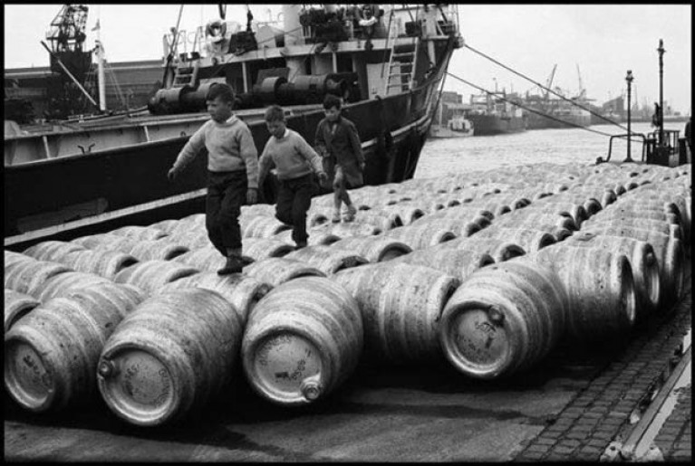 Playing on beer barrels in the Dublin Docks