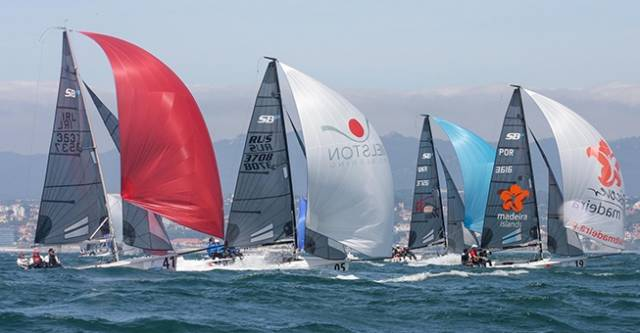 Royal St George YC's Chris Arrowsmith, David Cahill and Colin Galavan competing in yesterday's SB20 Worlds at Cascais