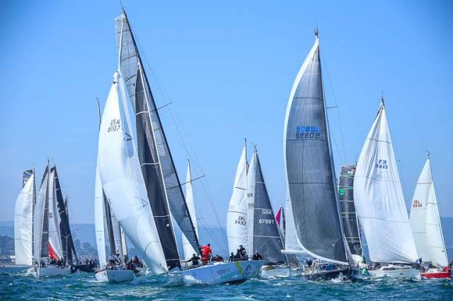 The Round Ireland Race start where Niall Dowling's Baraka GP makes a perfect start then shreds her spinnaker....