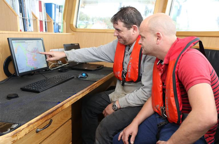 Online Fisheries Management Chart with real-time information on quotas and regulations now in use by industry  Pictured L-R: : Niall Connolly, MFV Patrick C and Val Reilly using the fisheries management chart online, October 2019