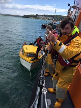 Coxswain Ken Cashman as he brings the stricken boat alongside the pontoon at Courtmacsherry Pier