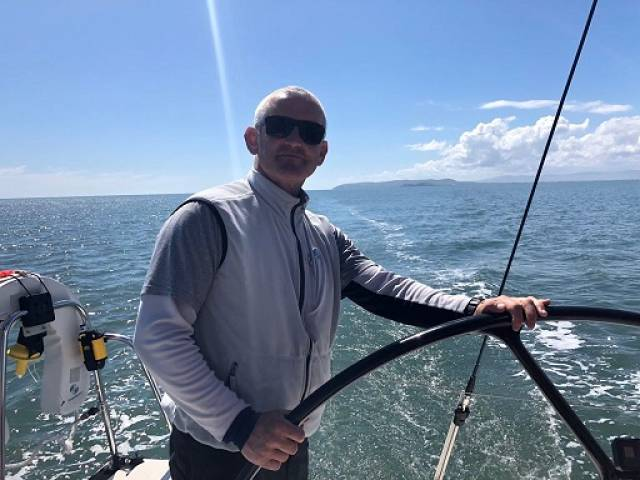 Prof O'Connell at the helm of Royal St. George yacht ISORA yacht Aurelia