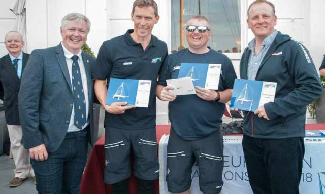 Royal Irish Yacht Club Commodore Joe Costello with SB20 Euro bronze medalists Ed Cook, Davy Taylor and Michael O'Connor