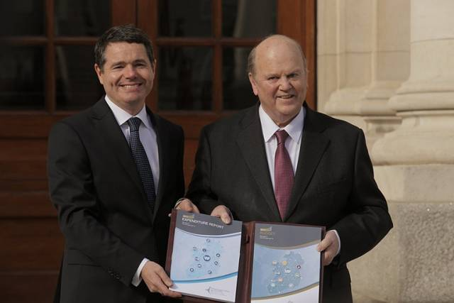 Ministers Donohoe (left) and Noonan arrive at Government Buildings for Budget 2017