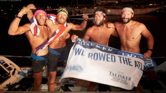 The Four Oarsmen celebrate their record-breaking win.
