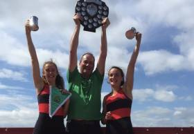 Aoife Lynch, Dan Buckley (coach) and Margaret Cremen after the Lee win in the Junior Women's Double.