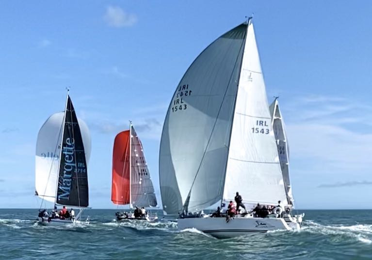 Indian summer hunt in the opening race of Howth's six weekend End-of-Summer Series – Simon Knowles' J/109 Indian in hot pursuit of the Classic Half Tonners Mata (left, Wright Brothers & Rick De Neve), King One (David Kelly), and on right The Big Picture (Michael & Richard Evans)
