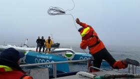 The crew of Oman Sail recover the trimaran. See video below.