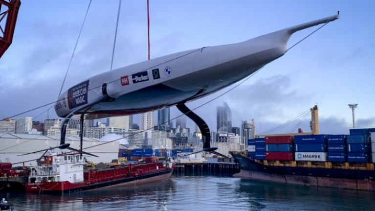 DEFIANT, the first AC75 racing yacht built for New York Yacht Club American Magic is lowered into Auckland harbour