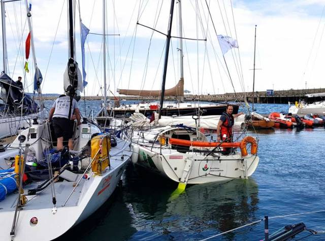 Co-skipper urgently needed…..Yannick Lemonnier aboard the Mini 6.50 Port of Galway in Dun Laoghaire alongside Liam Burke's Farr 31 Tribal, also from Galway