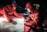 Santi Pablos and Blair Tuke cutting a piece of 3Di for MAPFRE's mainsail overnight