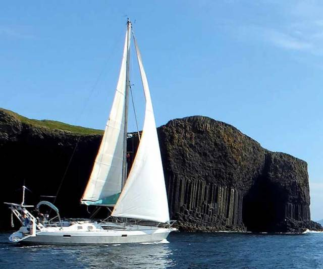 Donal Walsh's Ovni 385 Lady Belle from Dungarvan gets the best of the summer weather off Fingal's Cave in the cliffs of Staffa in the Hebrides during a wide-ranging North European cruise which has been awarded the Irish Cruising Club's premier trophy, the Faulkner Cup