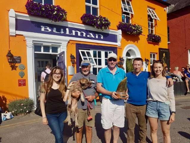 Bobby Nash (centre) & crew out side the Bulman Bar in Kinsale