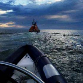 Donaghadee RNLI's all-weather lifeboat Saxon tows a RIB to safety  from the North Channel