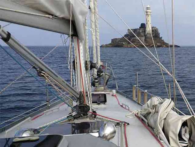 Fastnet Rock in calm waters at the start of the 109–day voyage on 12m Pylades