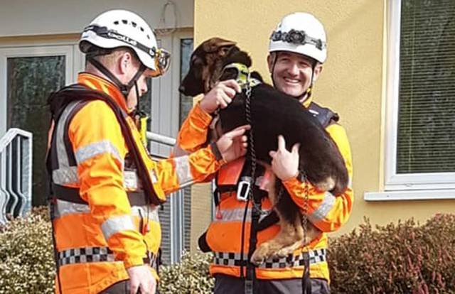 Killaloe Coast Guard volunteers with the dog they brought to safety along with its owners after their cruiser lost power