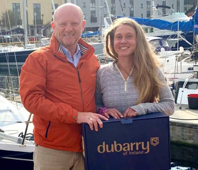 Michael Walsh of Dubarry presented Belgian solo sailor Caroline Adriens with a very practical gift of the latest Dubarry Shamrock Boots in Galway before she departed south on her dream voyage