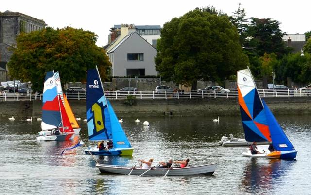 The CityOne Training Dinghies designed by Theo Rye on the Shannon in Limerick in company with one of the Ilen Boatbuilding Company's new-built traditional gandelows in September 2014