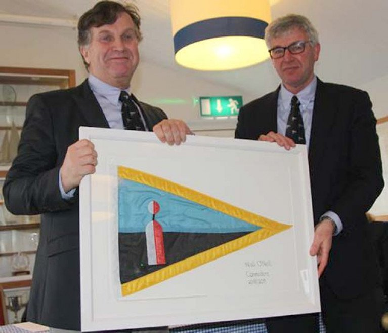Baltimore Sailing Club's newly-elected Commodore, Charlie Bolger, on right, presents past Commodore's Club Ensign to outgoing Commodore Niall O'Neill at the club's annual general meeting this week
