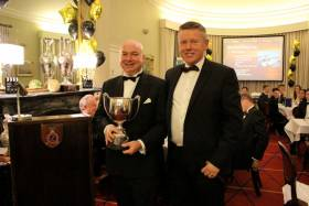 Chris Power-Smith (left) and Flag Officer Frank O'Beirne with last year's Commodore's Cup awarded for his and the crew of Aurelia's performance offshore in 2016