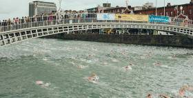 Spectators on the Ha'penny Bridge cheer on previous Liffey swimmers