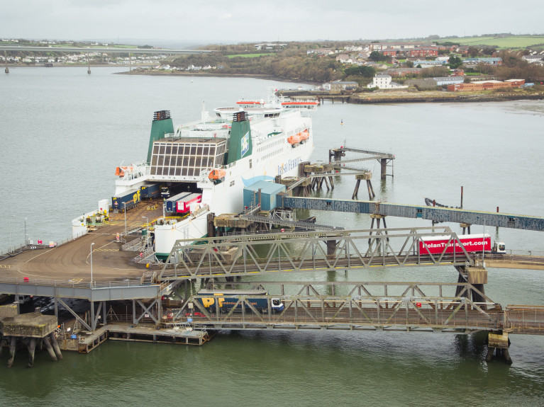 While lorries entering UK from Ireland will not face checks until July of next year, the same checks will be introduced from January 1 on traffic travelling from UK into Ireland. Above AFLOAT adds un-accompanied truck-trailers towed during disembarkation at the south Wales ferry port of Pembroke in Milford Haven. Note the two-tier linkspan serving Irish Ferries 122 freight unit capacity cruiseferry Isle of Inishmore operating on the Rosslare route.