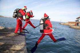 Santas taking the plunge at Sandycove for last year's Santa Scuba Dive