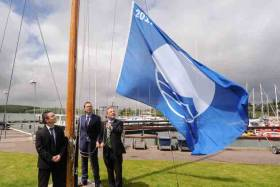 Flag raisers– (from left) Ian Diamond, An Taisce, Gavin Deane of Royal Cork and Senator Gerry Buttimer raise Royal Cork Marina's Blue Flag in Crosshaven yesterday