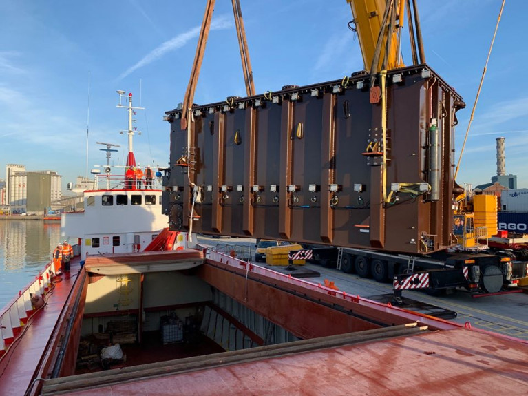 A 120 tonne transformer that was in the cargo hold of veteran vessel MV Saturn (1966/627grt) was discharged by Doyle Shipping Group (DSG).  The small red hulled ship is a survivor in this day of considerably increasing sized ships.