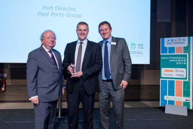 Port Director at Peel Ports, David Huck receiving the award from John Sergeant and Robert Jervis