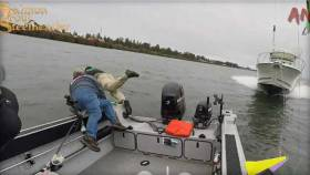 Three people are seen in still from video posted on magazine Salmon Trout Steelheader's Facebook page jumping into Columbia River at its mouth at the Pacific Ocean in Oregon in August 2017 moments before speeding boat barrelled down on theirs and hit it