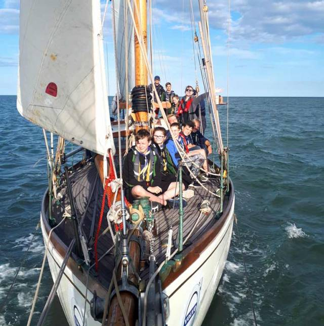 Summertime at Arklow. The vintage Arklow-built Round Ireland racer Maybird takes the local Sea Scouts for a sail as part of the celebration of her achievement in becoming the oldest and first gaff-rigged boat to complete the Round Ireland race
