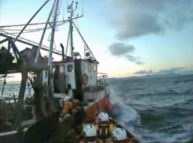 Kilkeel RNLI crew member Alexander McCauley boards the stricken vessel