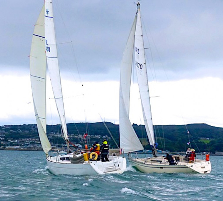 Mary Ellen (O'Byrne/Finucan/Carty HYC) and the vintage First 38 Out & About (Terry McCoy & Maurice Cregan, Skerries SC) neck and neck in the White Sails Division through the Sound towards the finish at Howth in the first race of the Fingal Cruiser Challenge